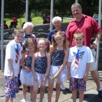 Parade Organizer John Quirk , Durham Town Board Member Linda Sutton, and the McGrath clan, winners of the 50/50 raffle