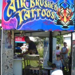 Dave Osborn of Osborn Entertainment working the Tattoo Booth